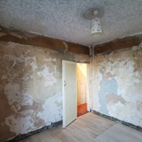Wallpaper stripping and wall repair
